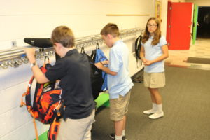 5th and 6th graders getting supplies out of their backpacks