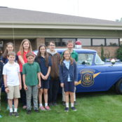 Posing in front of an early State Police Car