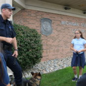 The children learn about the dog handlers in the MSP